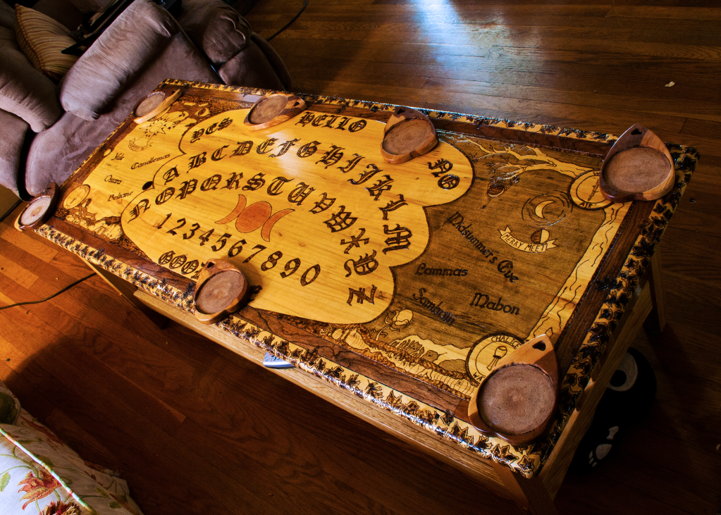 A ouija board coffee table complete with planchette coasters The
