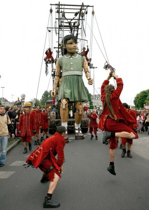 16-06-13: Royal de Luxe Nantes [I may have mentioned  my love of puppets. Royal de Luxe uses puppets in some of their street theater pieces. Street Theater probably does not conjure chaos and imagination at their scale. These are not mimes and living statues. They bring in power equipment, 50' marionettes, and armies of footmen to close cities down. Amazing.]