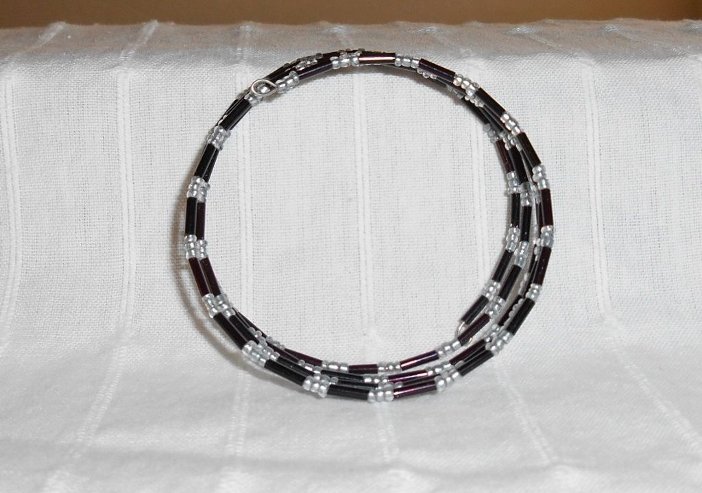 Black bugle and stainless steele seed bead memory wire bangle