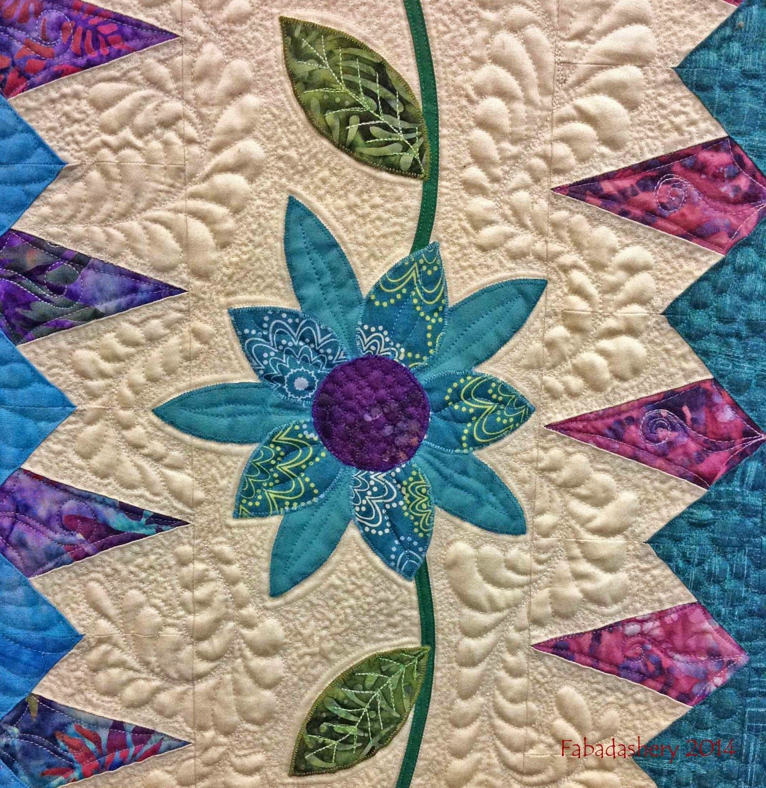 a a detail enchanted garden quilt by rhianon taylor