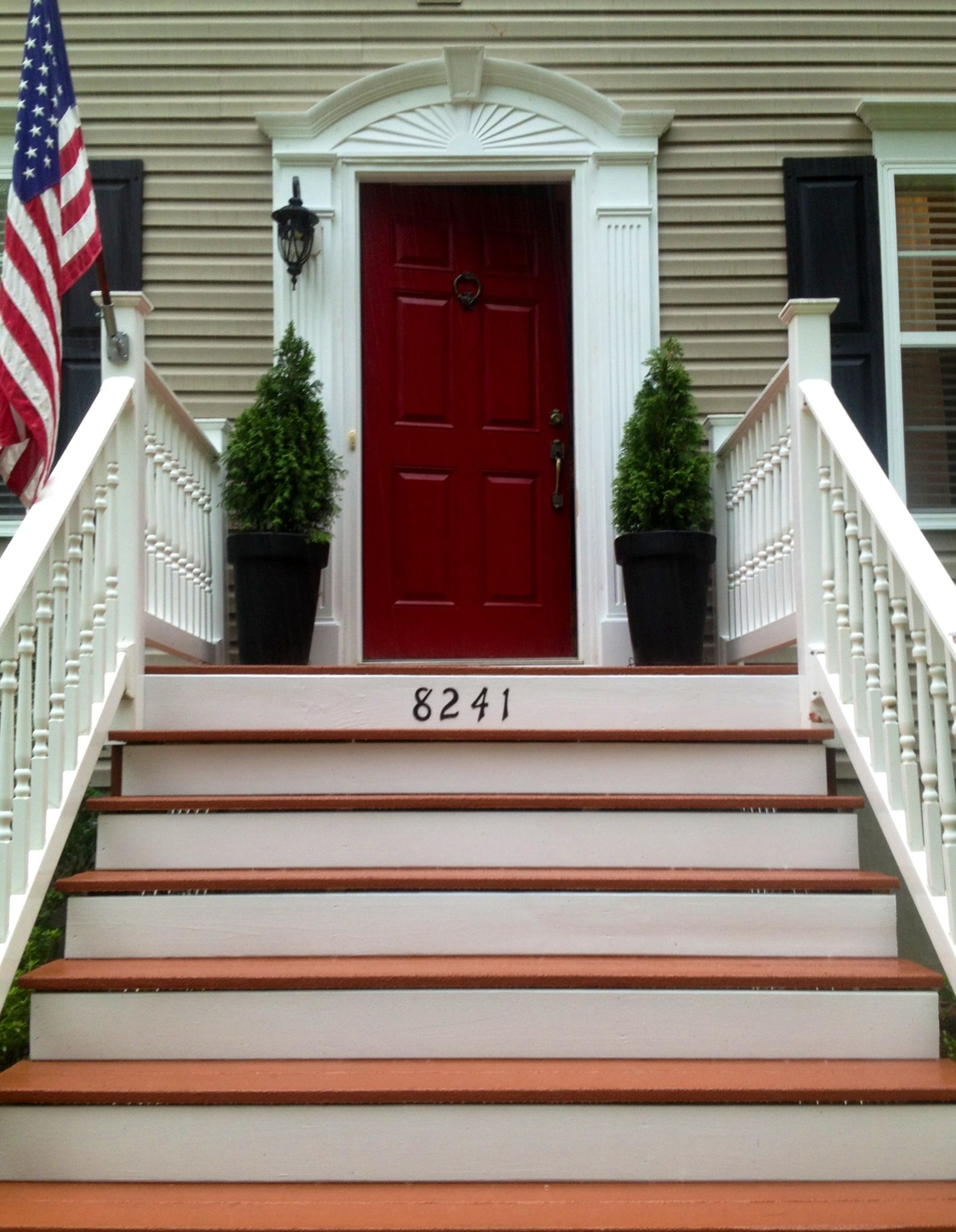 House number on wooden front steps done with rustoleum for Front step designs wood