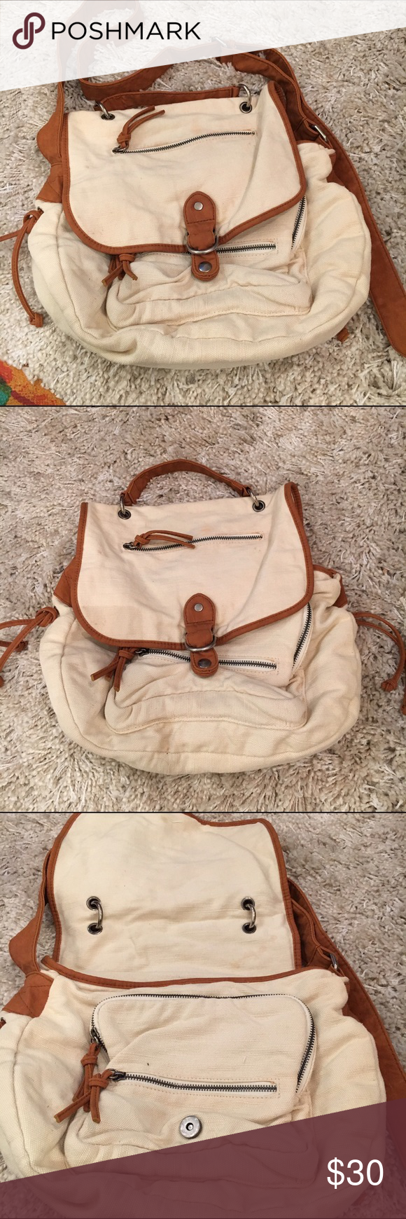 """Urban Outfitters Washed Canvas Satchel Cooperative by Urban Outfitters washed canvas satchel in ivory with brown lining and straps.  Aprox 10"""" length x 14"""" width, 5"""" depth/thickness Urban Outfitters Bags Satchels"""
