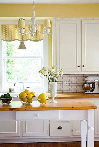 Superieur Thereu0027s Something Undeniably Cheerful About A Sunny Yellow Kitchen. I Also  Love The Counter Tops, Curtain And Chandalier