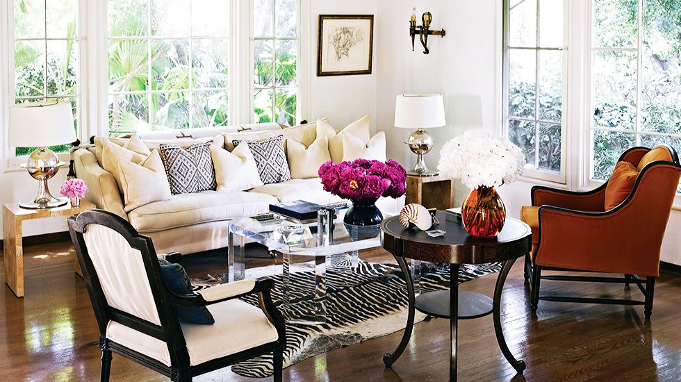 17 Beautifully Feminine Rooms to Get Inspired By// lucite coffee table, zebra hide