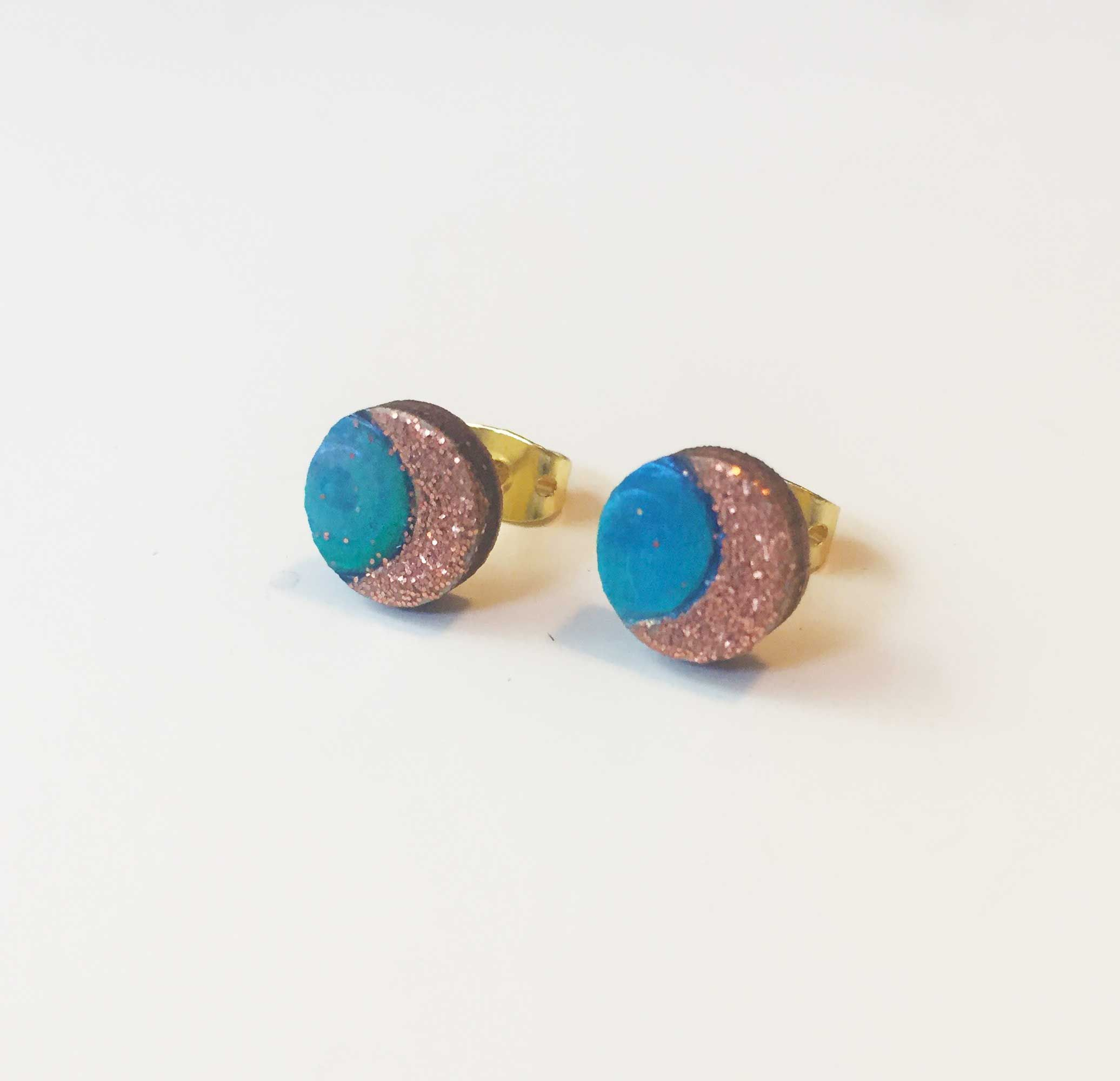 These Half moon light stud designs sparkle with rose gold glitter