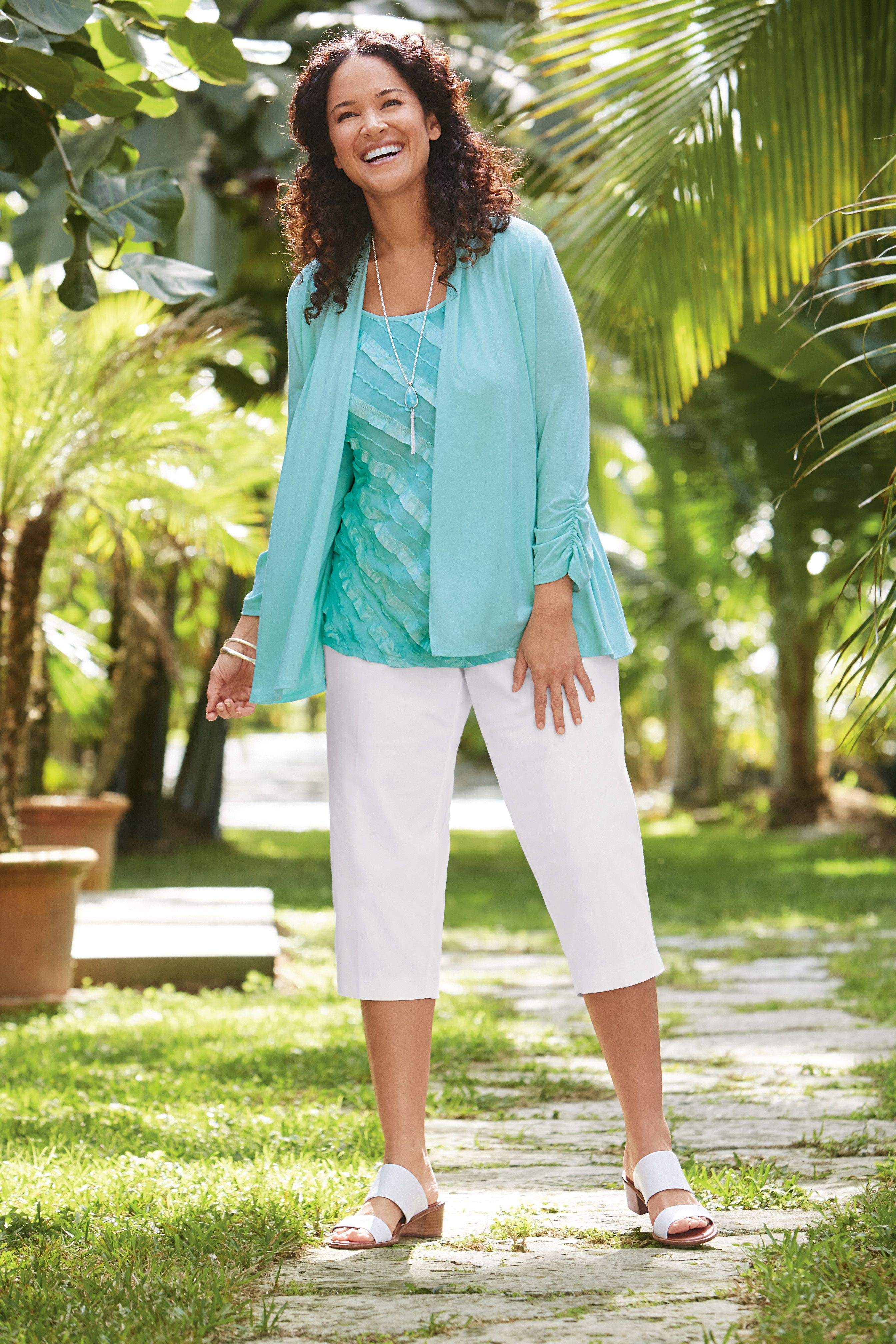 Kim Rogers Plus Size Ruched Sleeve 2Fer & Slimming Solutions Capri Pants. This combination offers a figure-flattering look that's ideal for any casual occasion.