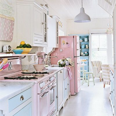 Pink Refridgerator Stove And Mixer Complete This Pastel Kitchen With White Walls A Light