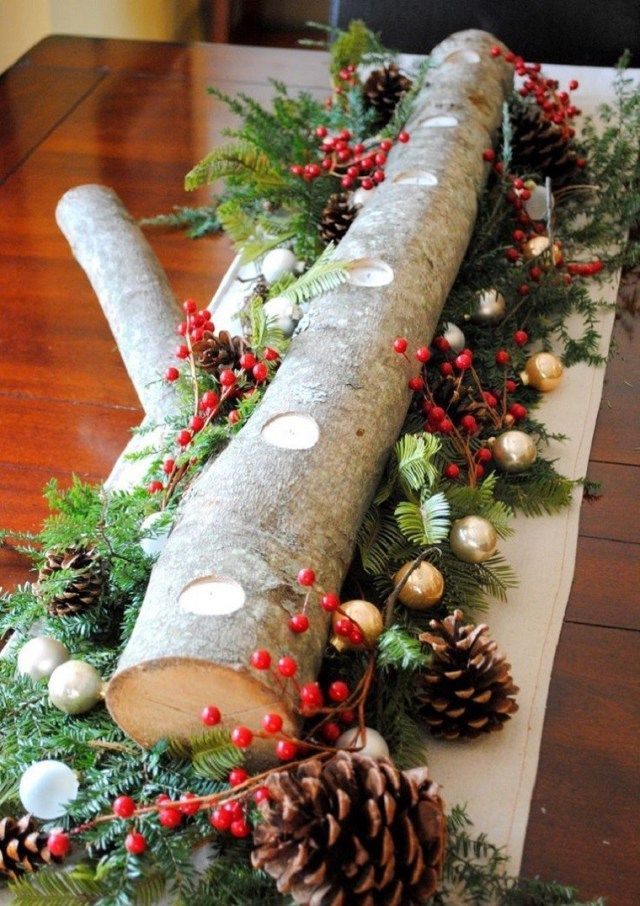Centros de mesa navideños con troncos de madera Centros de mesa