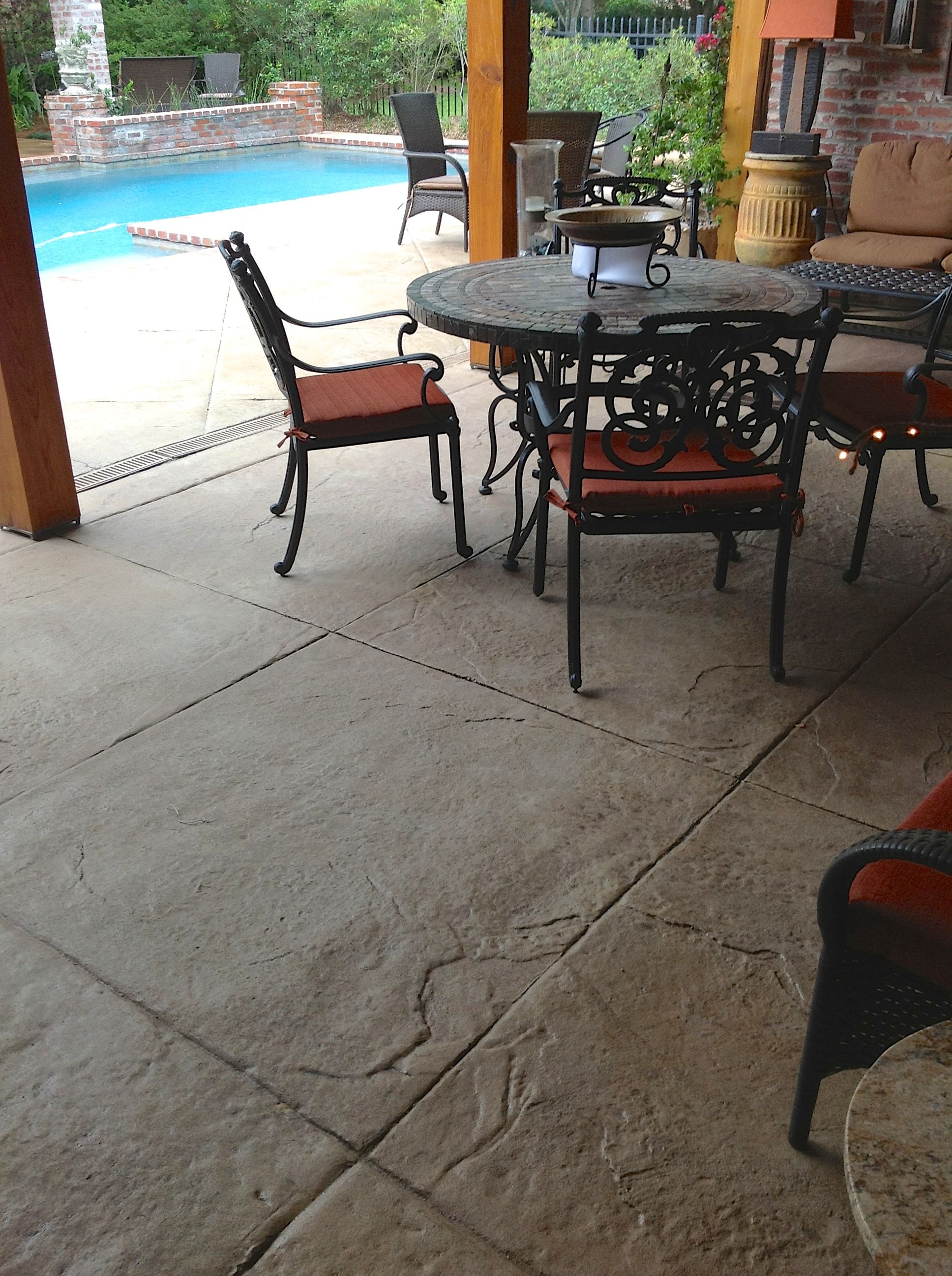 Stamped textured concrete patio area with diamond scoring pattern (1 on