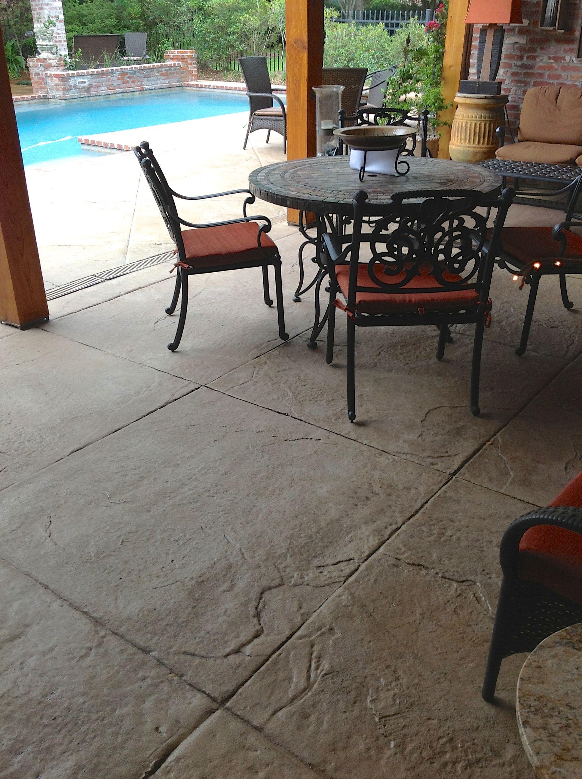Stamped textured concrete patio area with diamond scoring ...