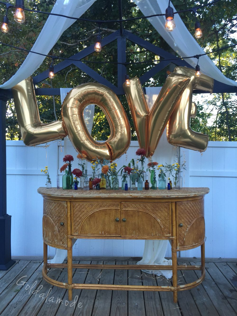 gold letter balloons antique bottles and antique furniture for a