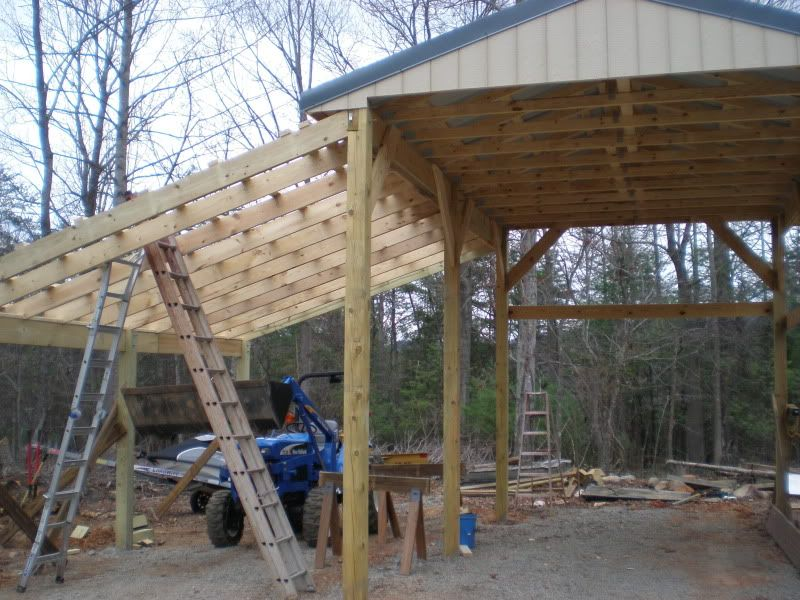 Lean to patio cover attached to roofed area pole barn for Rv shed ideas