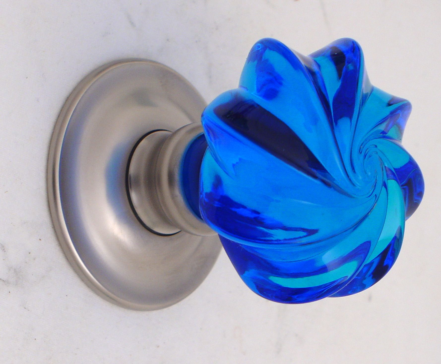 Bright Blue Glass Whirl Door Knob On A Satin Nickel Rose By Merlin