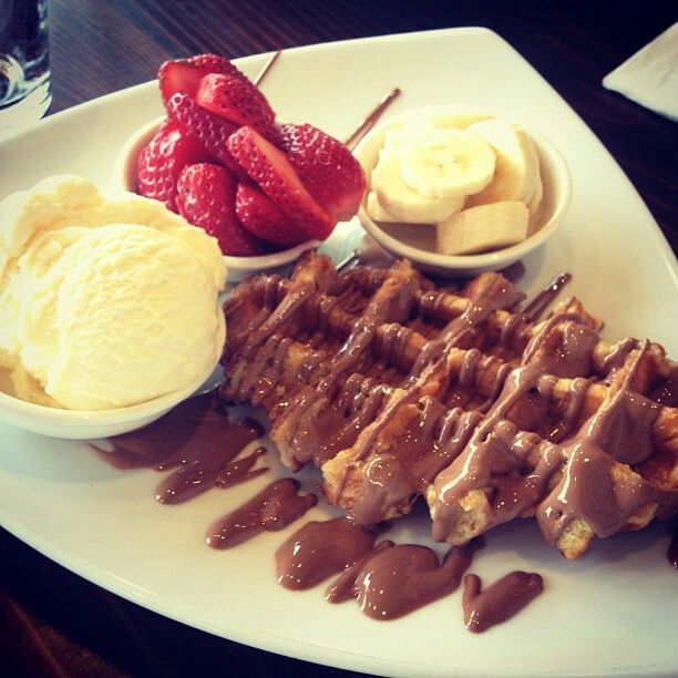 Waffles with ice cream, strawberries and bananas