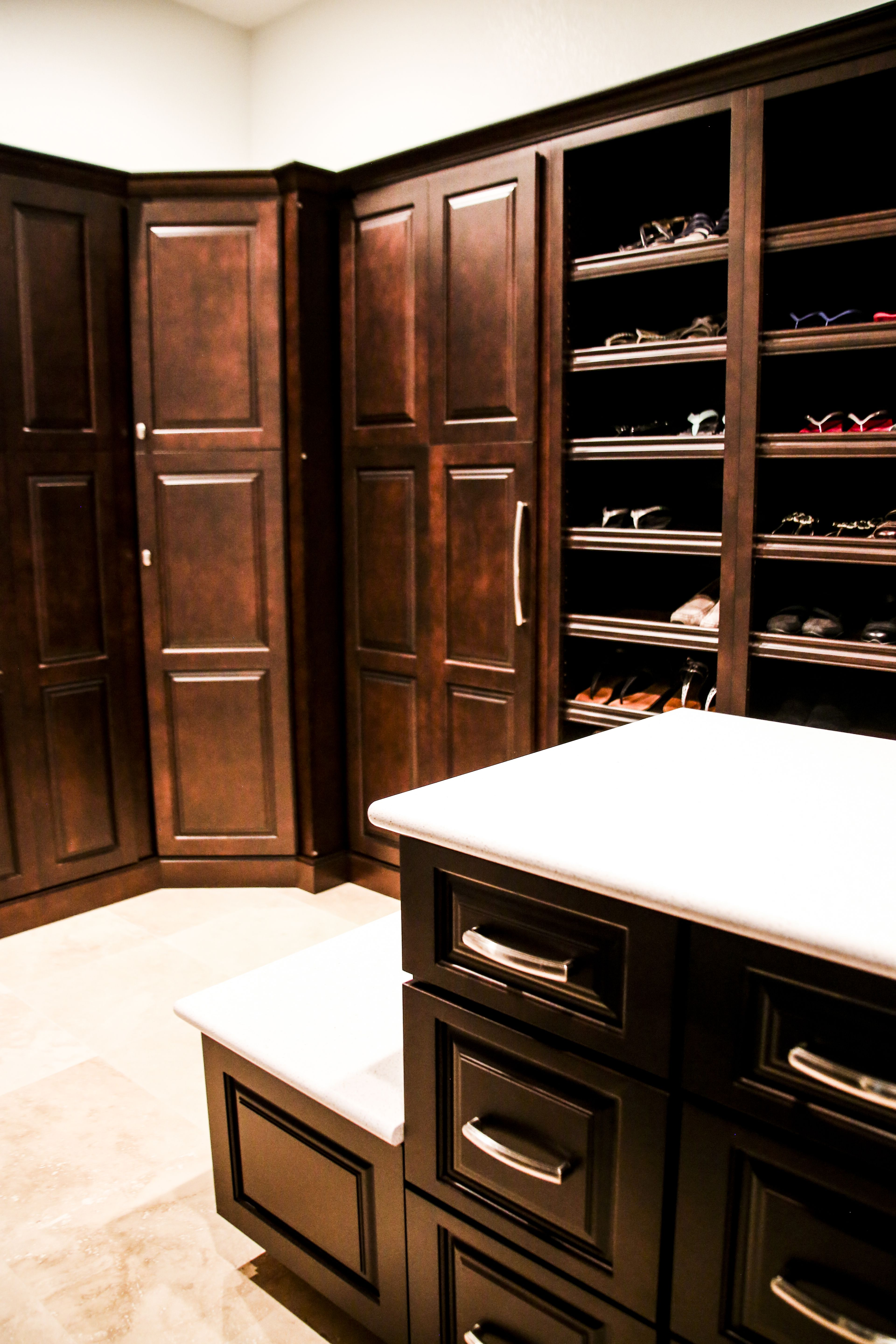 Incredible hidden folding door custom closet with jewelry island ...