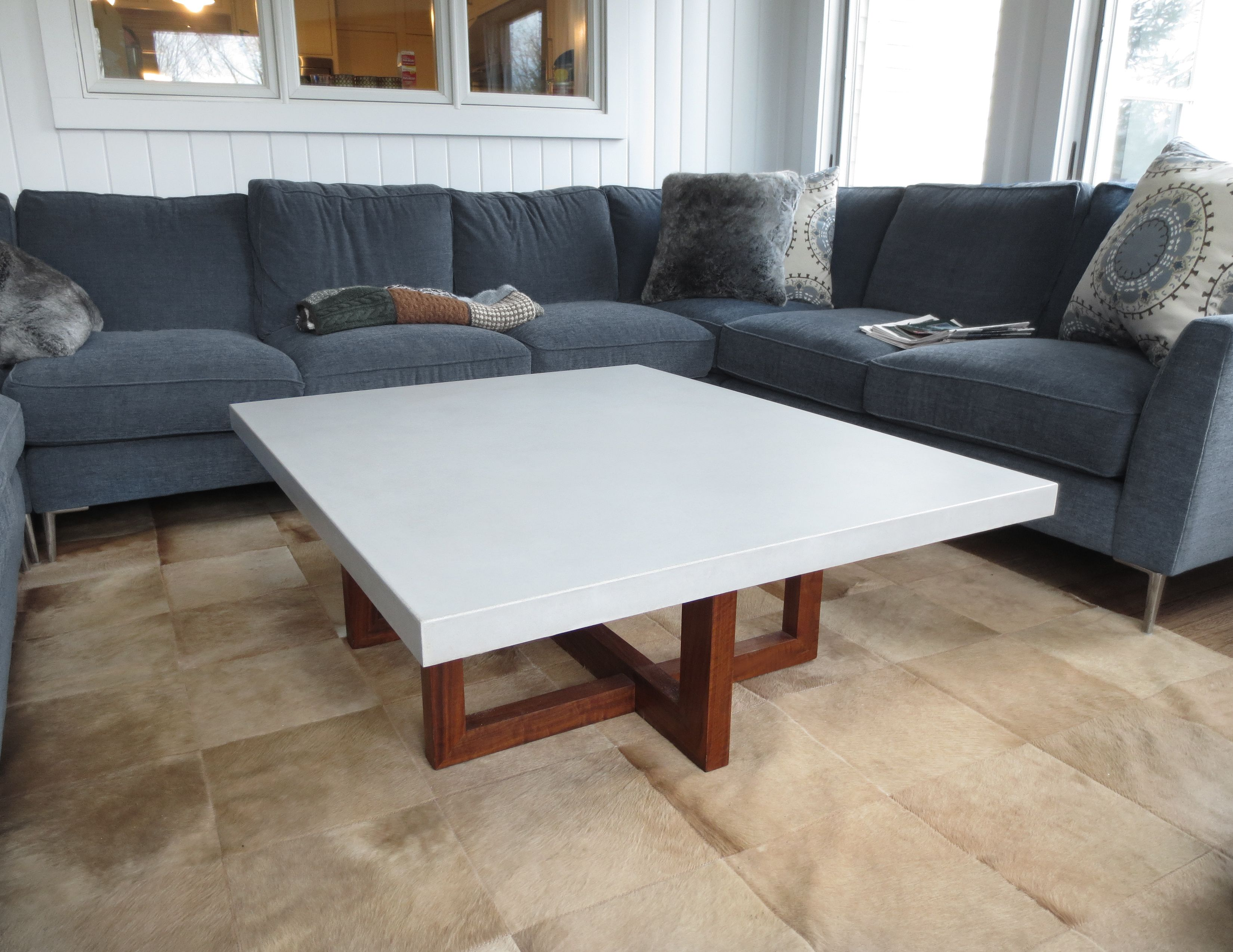 This is a concrete coffee table with a wood base the table top was just a cap that was made to sit on existing table base.