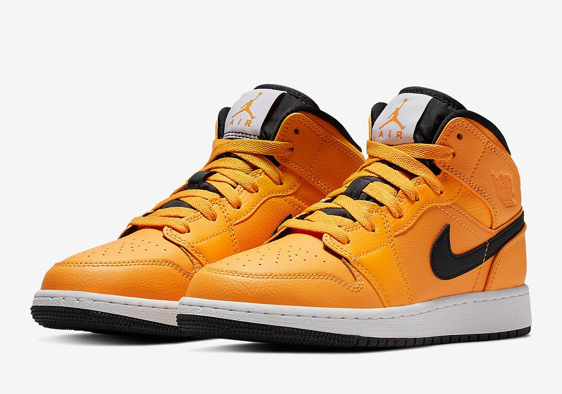 00a6a6041ab9fb The Air Jordan 1 Mid Gets A Full Bright Taxi Yellow - SneakerNews.com