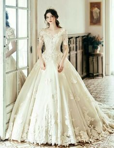 This princess-inspired wedding gown from Clara Wedding featuring floral lace detailing is hard to resist!