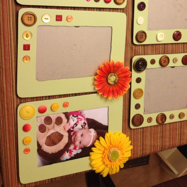 Paint a border around a glass frame then decorate with buttons and flowers.