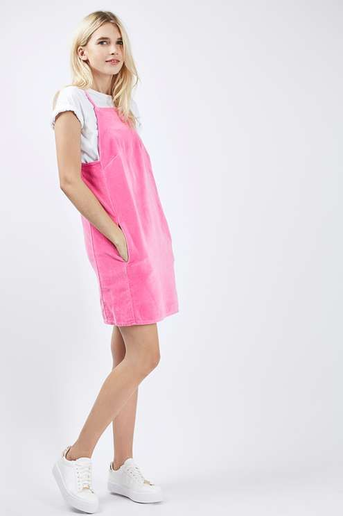 050bacc844c8 Give your casual-wear a cool spin in this MOTO utility style velvet pinafore  dress in bright pink. A boxy silhouette cut with a square neckline and deep  ...