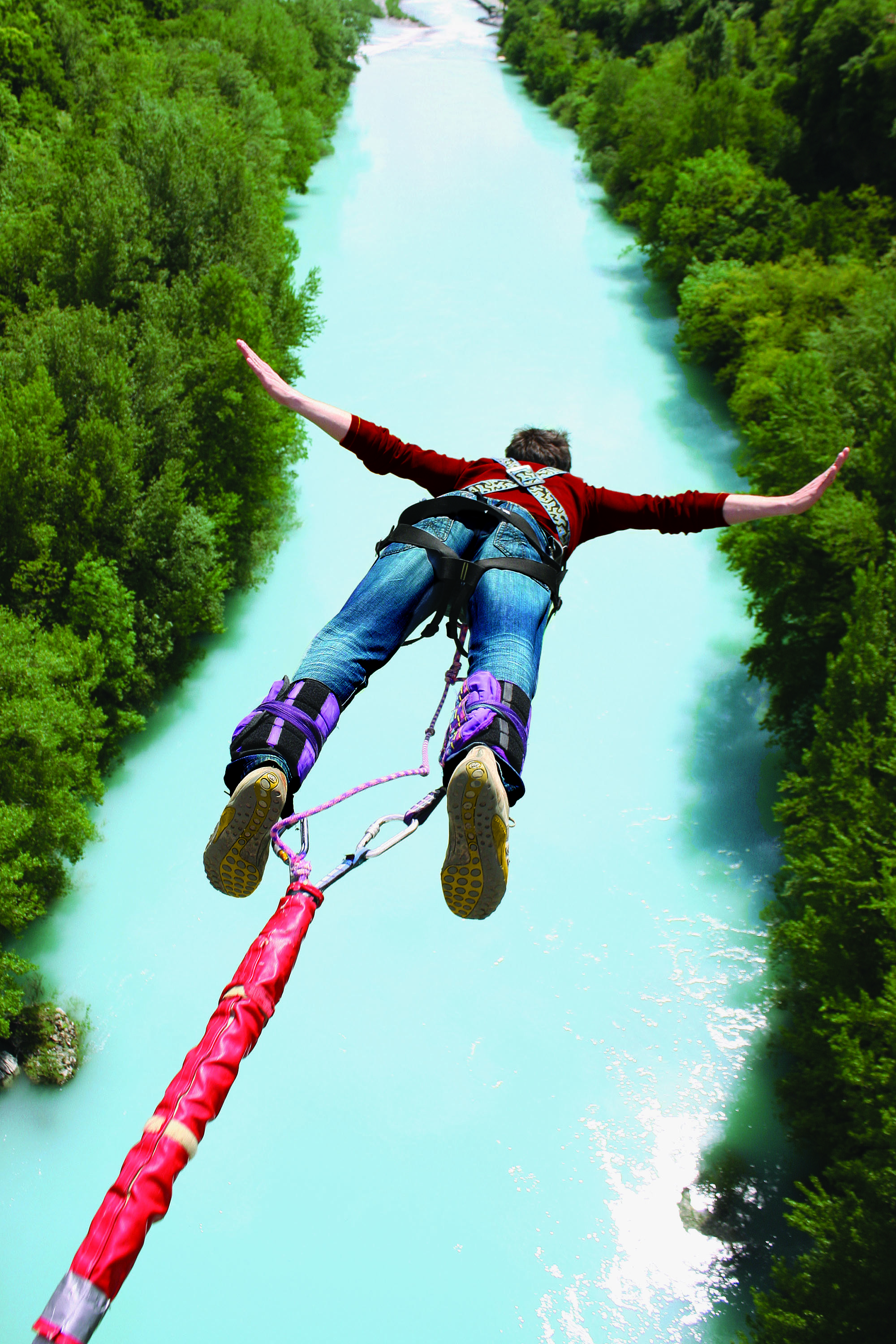 Bungee Jumping.Exciting Experience Of The Bungee Jump From The Bridge Over The