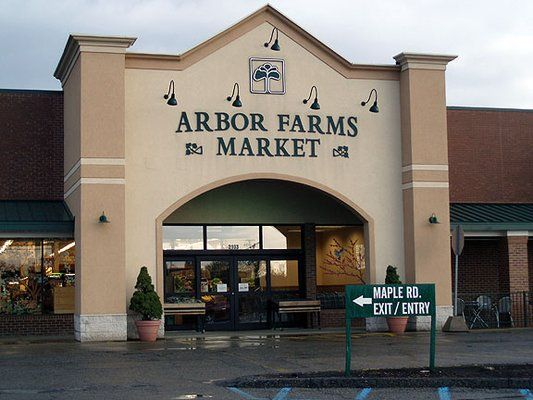 Arbor Farms Market.  Tons of Michigan products, very fresh produce, sustainable seafood and meats!  Right off Stadium in A2.