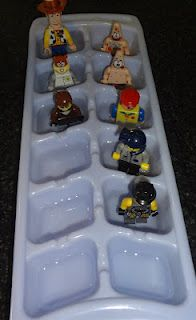 Toy figurines on ice.  Freeze characters in ice cube tray, then let kids play with them on a cookie sheet.  Ice Capades kid style!