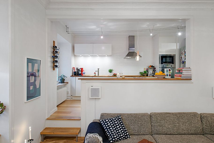 Dazzle Swedish Apartment Exhibiting an Original Floor Plan with Minimalist Kitchen Set and Dining Room on White Wall Decor Wooden Floor