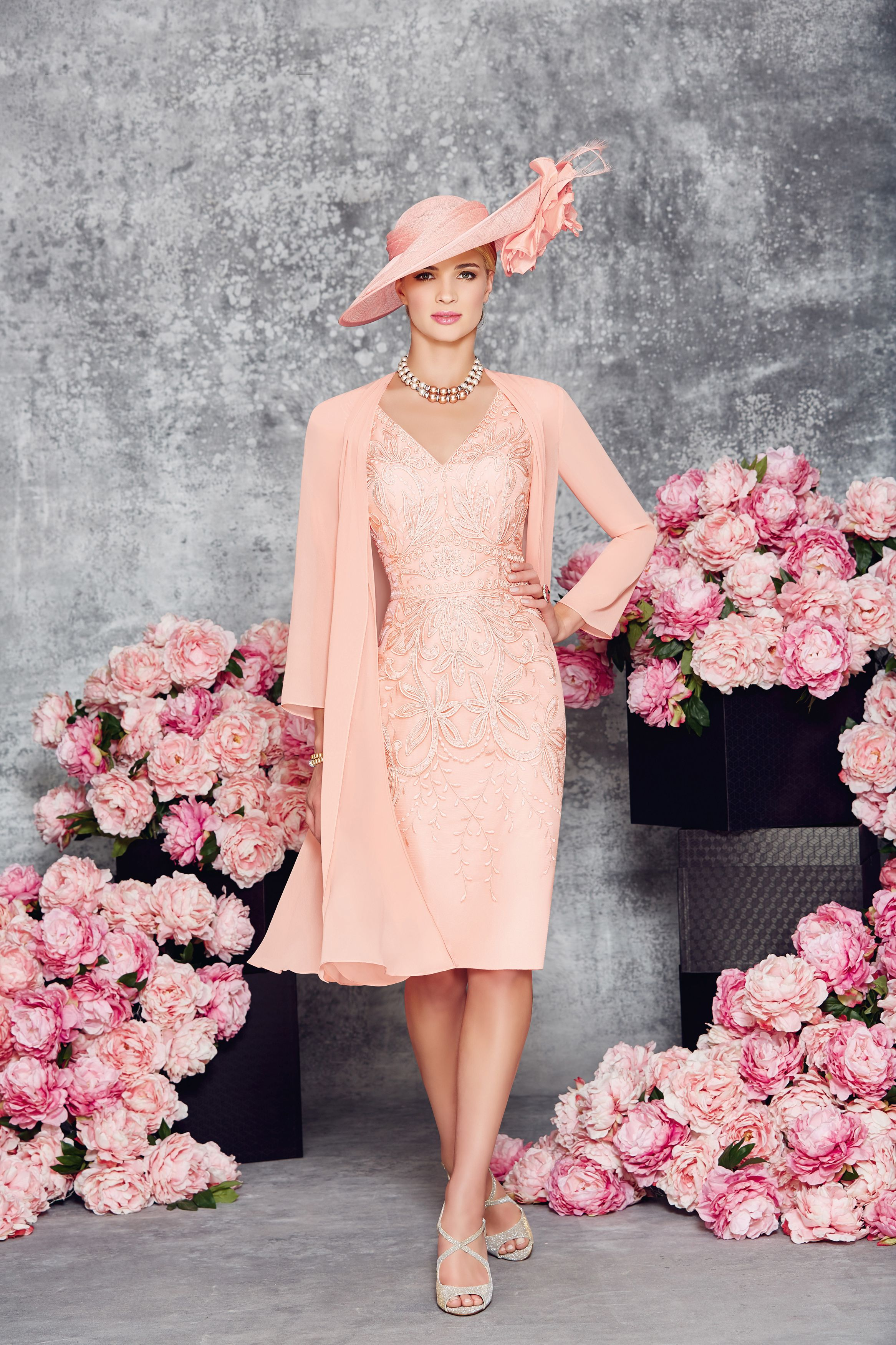 Short tailored dress with v neck and slight capped sleeve. There is ...