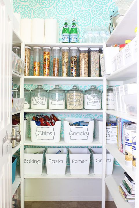 Don't hunt through mountains of cardboard boxes. Instead, take a few minutes to transfer ingredients and snacks into clear canisters so you can skip reading labels – and inspire a uniform tidiness. Click through for more on this and other pantry organization ideas.