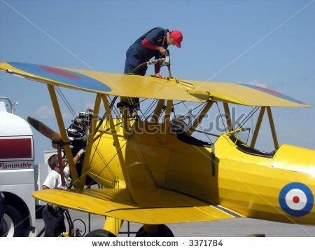 Refuel the plain. Show people and their work. Technician refueled the vintage airplane in between the flights. #editorial #stockphotography #aviation #Boeing_Stearman #vintage