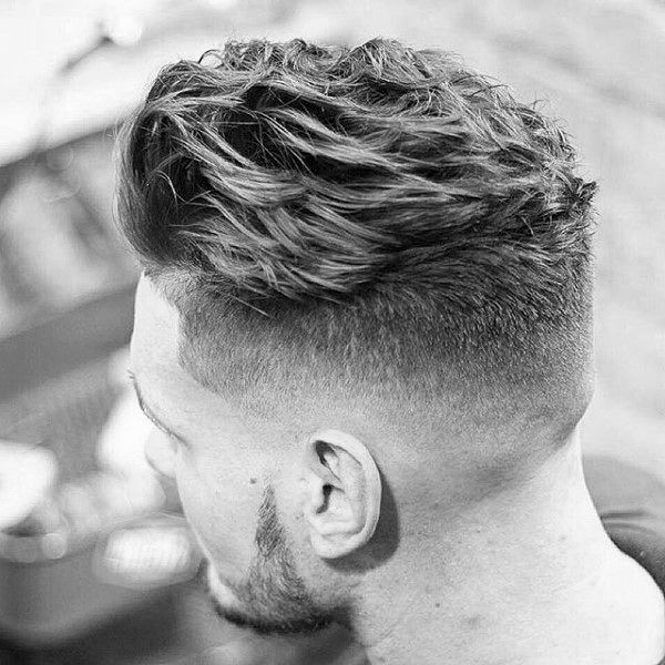 Mens Wavy Hairstyles backswept side parted mens hairstyle Dapper Mens Short Wavy Hair