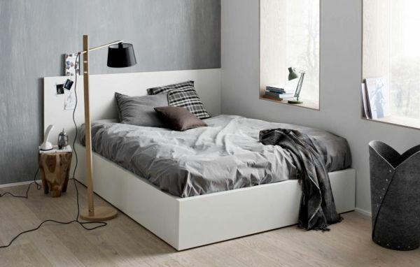 Skandinavisches design schlafzimmer  bett mit grauen bettwäschen im schlafzimmer - skandinavisches design ...
