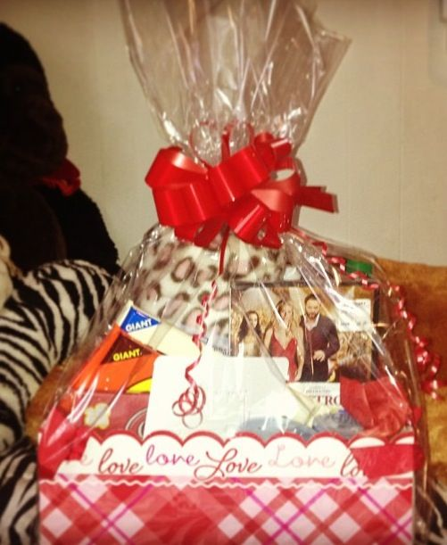 diy date night gift basket filled with a blanket a movie popcorn