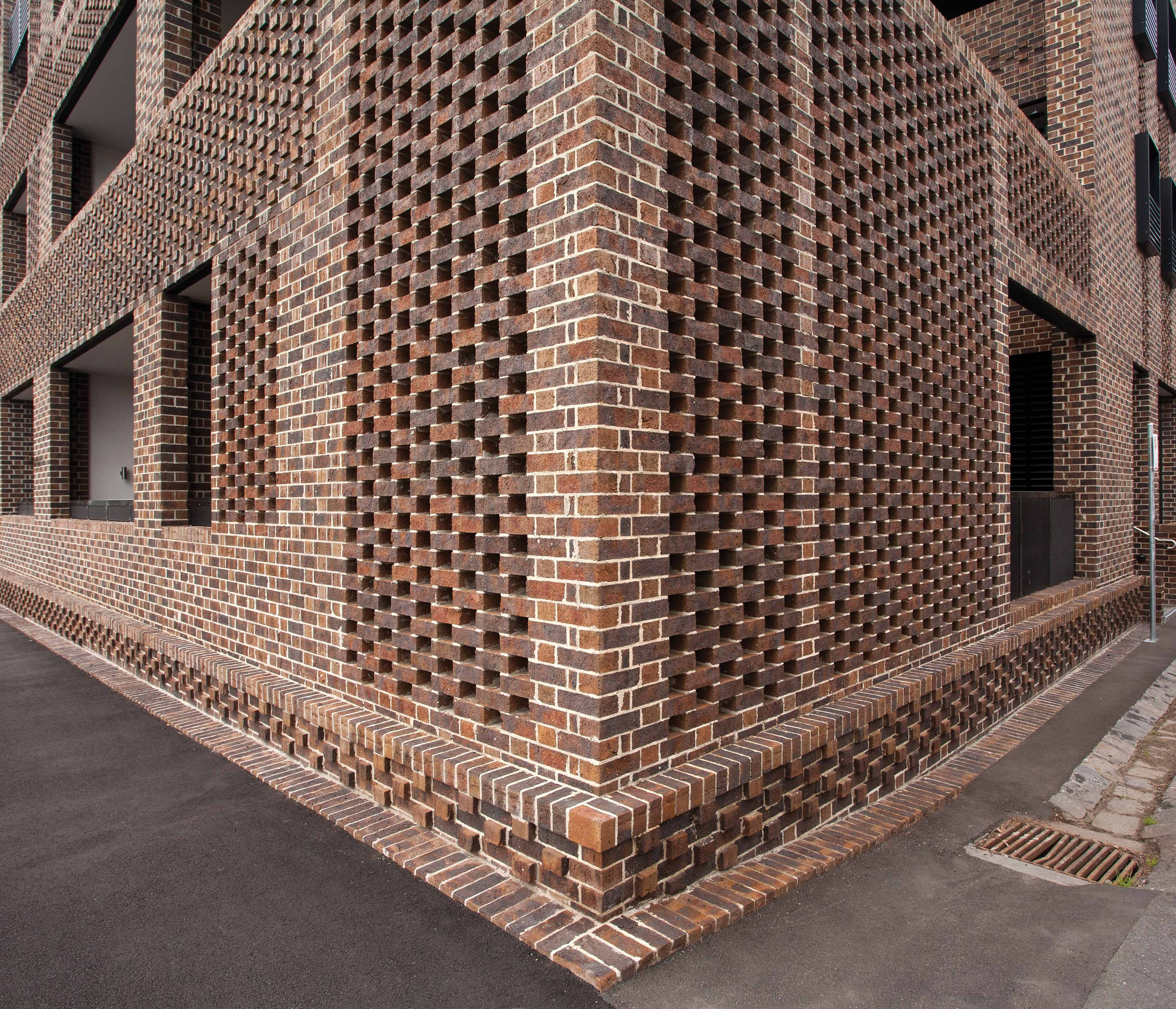 Brick parapet perforated google search brick design for Cool brick wall designs