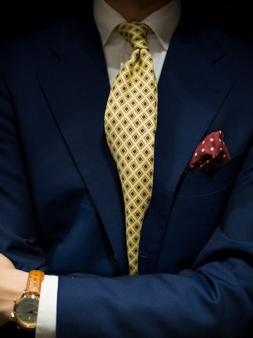 7d446cd6087d classic; navy blazer, gold tie with contrasting pocket square. next step;  enter the boardroom