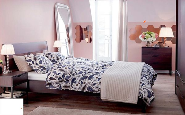 2015 bedroom design IKEA  featuring bold patterned bedding ans soft toned walls.