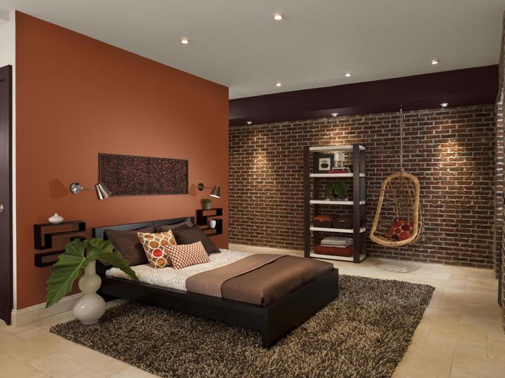 Orange accent wall looks great with brown accents the for Brick accent wall bedroom