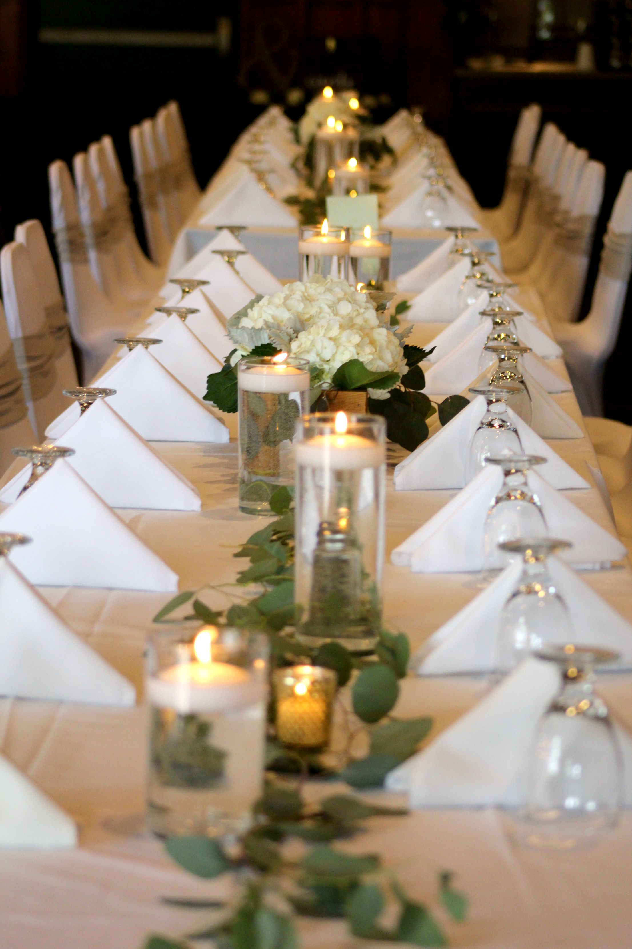 Wooden box centerpieces with white hydrangeas and greenery
