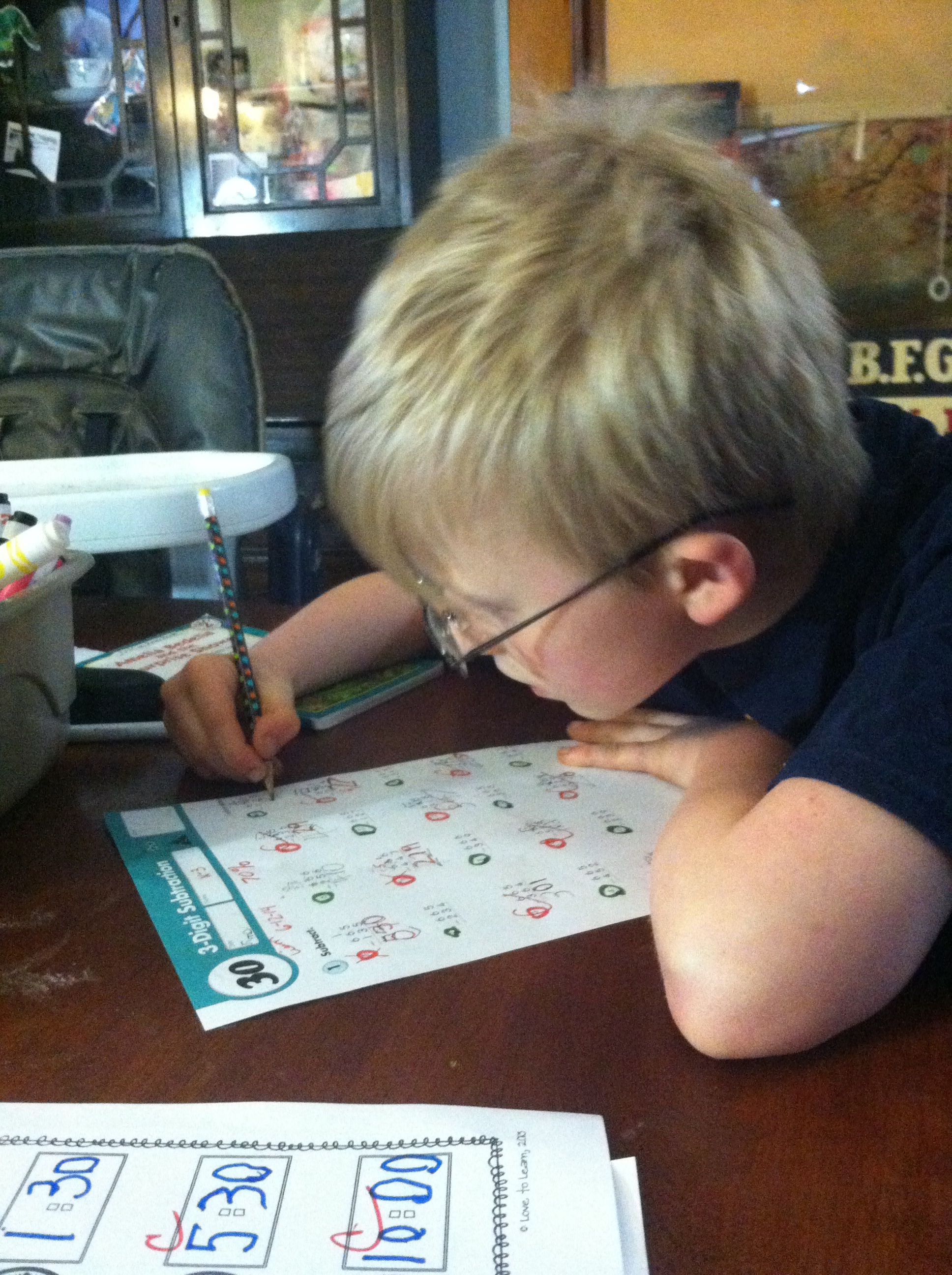 Working On A Math Worksheet From Kumon