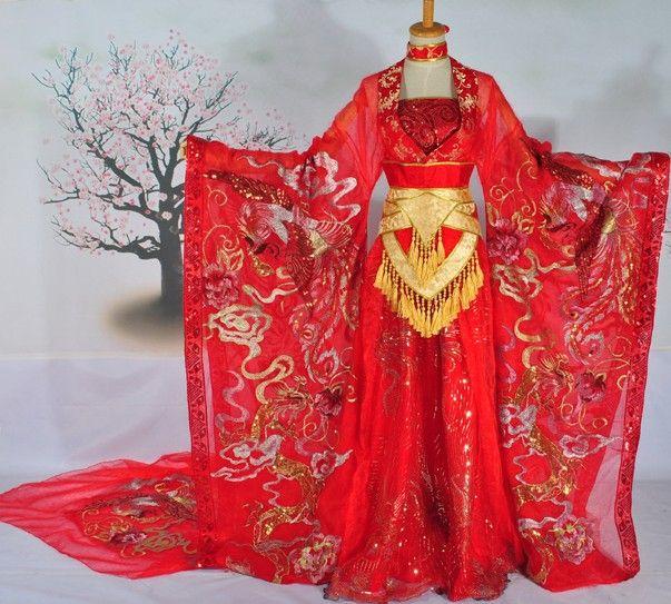 Chinese Classic Auspicious Phoenix Wedding Dress. A bit flashy for me... but still very pretty.