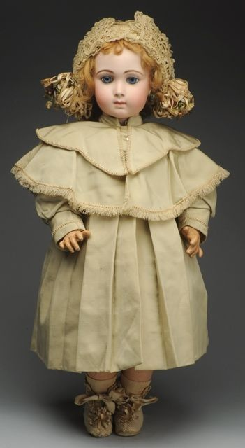 Exceptional French Long Face Jumeau Bébé Doll. Antique white cotton dress and underwear, coat from antique fabrics, lacy antique hat, shoes and socks. Lovely large doll!