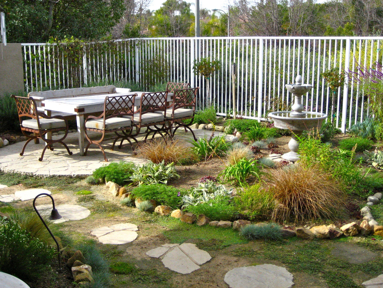 Garden And Patio Rustic Bakcyard House Design With Footpath Raised ...