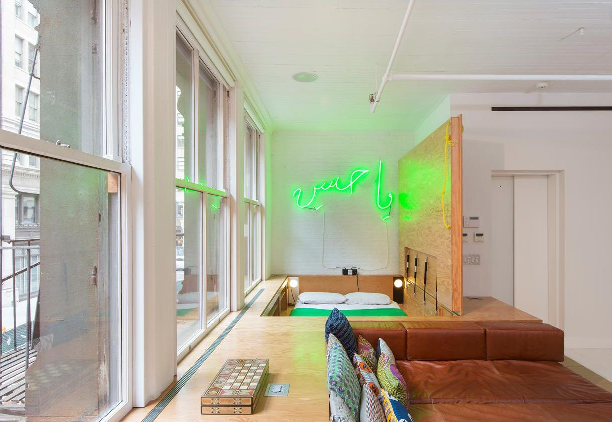Zen loft in tribeca complete with neon signs and beatles inspired