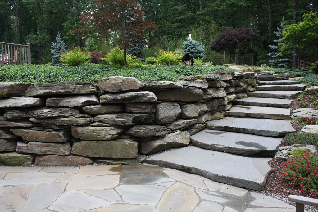 Landscape natural boulder wall stone staircase in for Rock wall garden