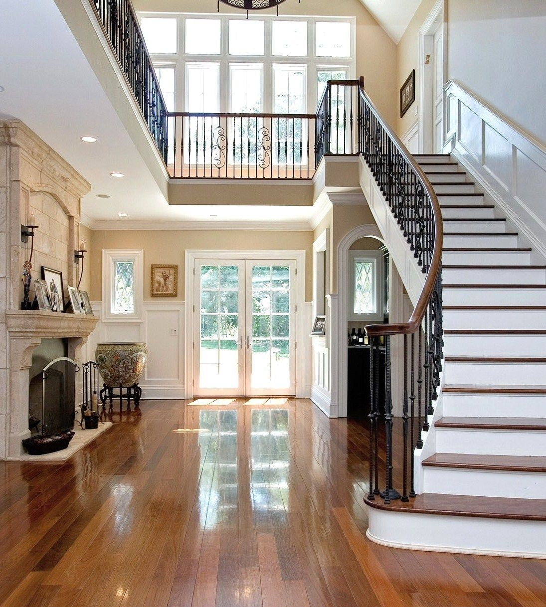 Beautiful Front Hall And Staircase: Limestone Fireplace And Juliet Balcony