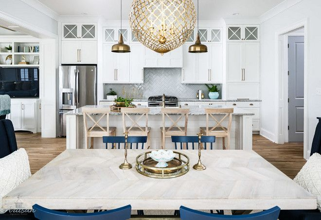 White Kitchen With Brass Lighting And Navy Accessories. Beautiful White  Kitchen With Brass Lighting And Navy Accessories