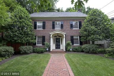 Stately brick center hall colonial with large public rooms on