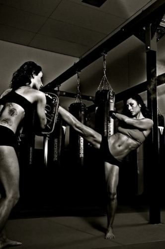 Kickboxing. See this woman? How muscular but fit her body is? Yea that's what I view as beautiful.