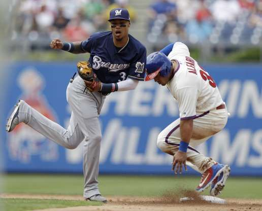 2ac551cd6 Get outta my way! Brewers' Orlando Arcia, left, leaps out of the way after  forcing out Phillies' Jorge Alfaro at second base on a fielder's choice by  Jake ...